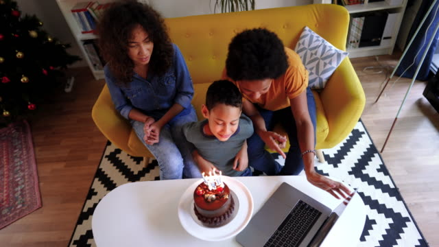 small family birthday party during pandemic - family with two children stock videos & royalty-free footage
