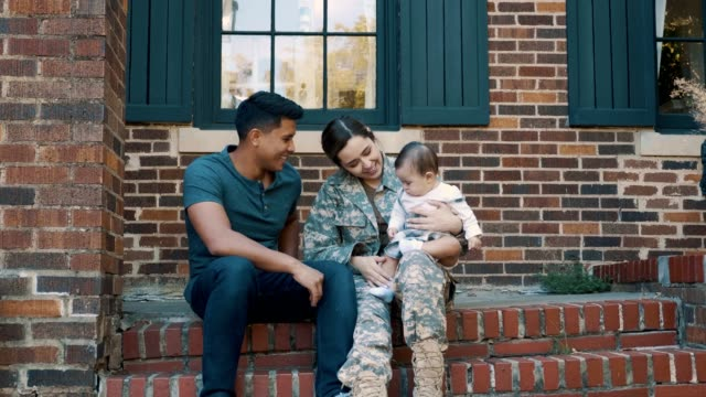 small family is reunited after female soldier's return from military assignment - war veteran stock videos & royalty-free footage