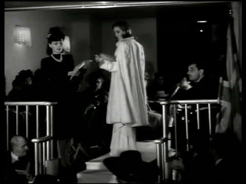 small fashion show w/ model modeling evening gown threequarter length fur cape ms president roosevelt's daughter anna smiling sitting w/ back to wall... - three quarter length stock videos & royalty-free footage