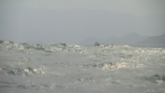 A small fishing boat in the choppy seas around Taiwan