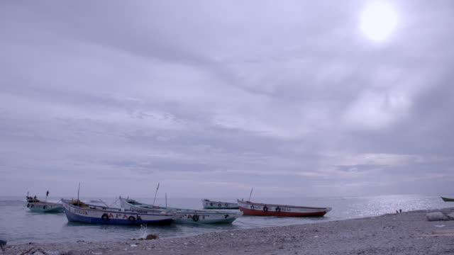 ws of small fishing boats moored on haitian beach - hispaniola stock videos & royalty-free footage