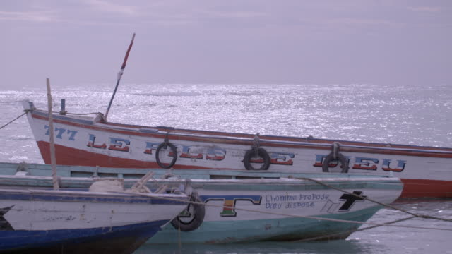 MS of small fishing boats moored on Haitian beach