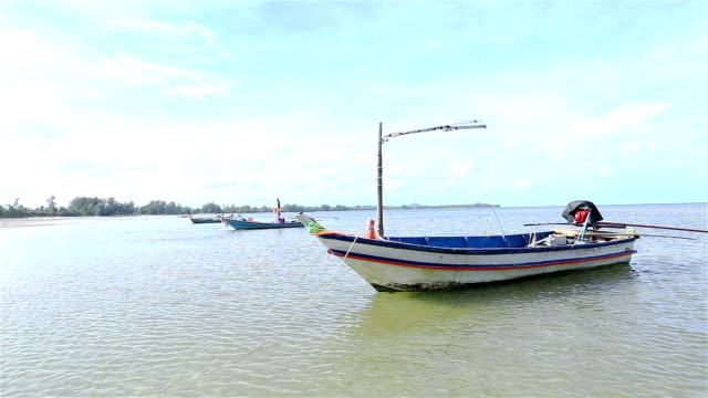 Small fishing boats moored on the beach.