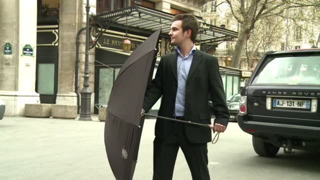 a small french company has developed the world's first attackproof umbrella for vip protection dubbed the 'sarkozy umbrella' after french secret... - dozen stock videos & royalty-free footage