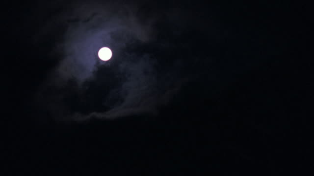 ws small full moon with clouds cover - vollmond stock-videos und b-roll-filmmaterial