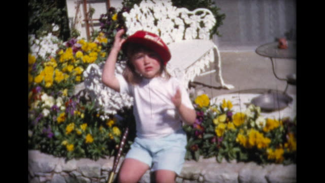 1965 small girl in large red cap - baseball cap stock videos & royalty-free footage