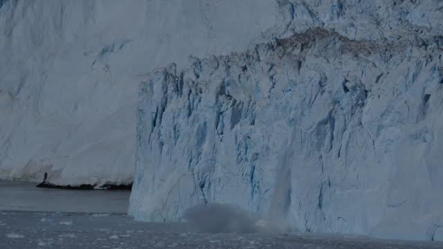 small glacier calving triggers off huge calving - glacier stock videos & royalty-free footage