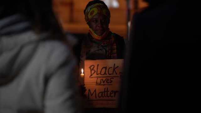 small group hold a candlelit vigil to mark what would have been the birthday of george floyd, in windrush square in brixton on october 14, 2020 in... - memorial video stock e b–roll