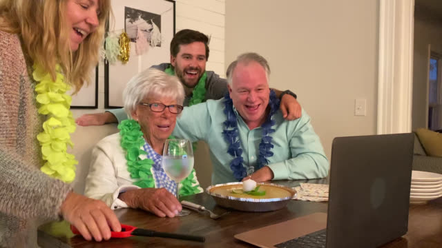 small group of happy adults hold virtual birthday celebration for grandmother (audio) - birthday cake stock videos & royalty-free footage