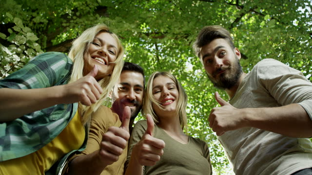 small group of happy friends showing thumbs up - small group of people stock videos & royalty-free footage