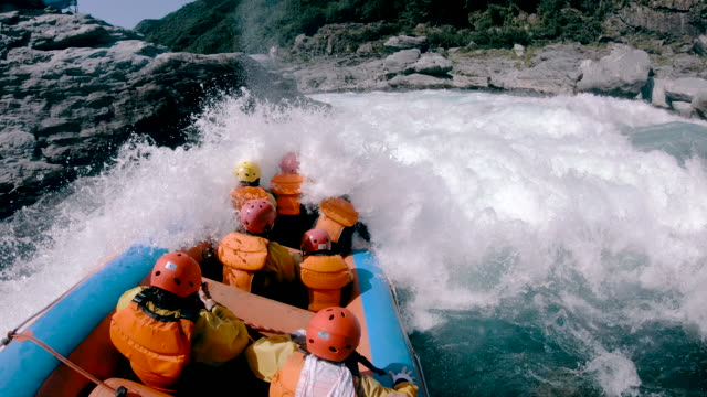 small group of men and women white water river rafting - rafting stock videos and b-roll footage