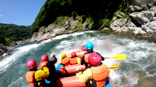 small group of men and women white water river rafting - inflatable raft stock videos and b-roll footage