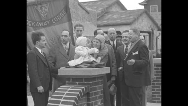 small group of men stand around woman and baby ramon pike seated on brick wall rockaway lodge flag behind them i bain holds knights of pythias... - insignia stock videos and b-roll footage