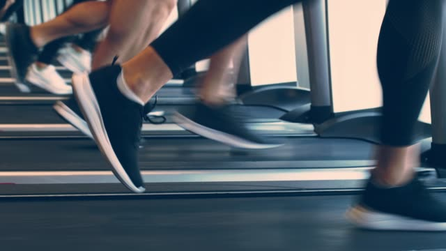 small group of people running on treadmills at the gym - endurance stock videos & royalty-free footage