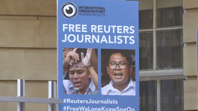 a small group of protesters gathers outside the myanmar embassy in london to protest against the jailing of two reuters journalists and demand aung... - reuters stock videos & royalty-free footage