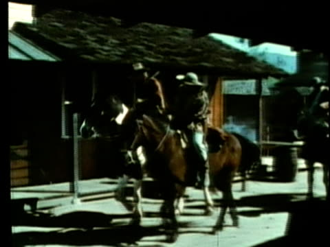 stockvideo's en b-roll-footage met 1963 reenactment ws small group of texan men arriving on horseback / republic of texas / audio - manifest destiny