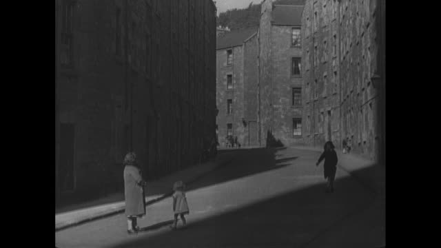 montage small groups of children playing in the street / dundee, scotland, united kingdom - 1944 stock videos & royalty-free footage