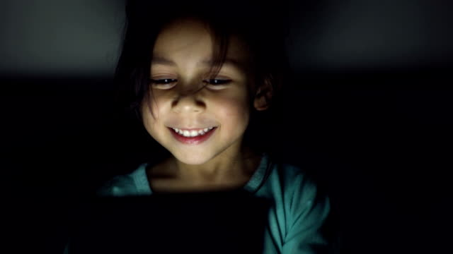 vídeos de stock e filmes b-roll de small happy child with tablet. - criancas