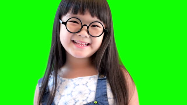 small happy girl laughing on green screen