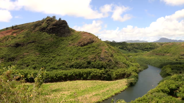 small hidden river on kauai island - butte rocky outcrop stock videos & royalty-free footage