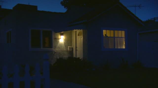 zip, cu, small house illuminated at night, lights off, los angeles, california, usa - night stock videos & royalty-free footage