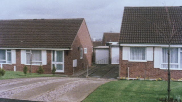 1983 montage small houses dedicated for senior citizens with a new one under construction / united kingdom - bungalow stock videos and b-roll footage