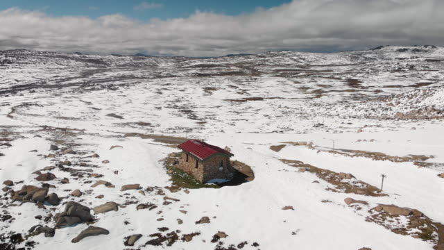small hut perched on a mountainside - remote location stock videos & royalty-free footage