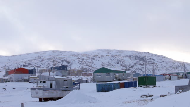 A small Inuit village on the edge of a lake in the far north