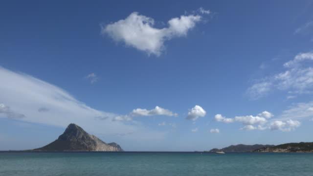 td / small island in sea at sandy beach - sassari stock videos & royalty-free footage
