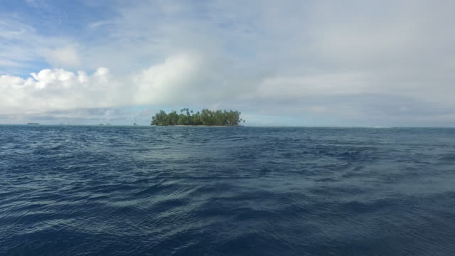 small island with coconut palms surrounded by the sea - tahaa island stock videos & royalty-free footage