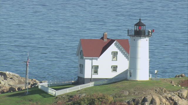 aerial small island with cottage and lighthouse on bluff / york, maine, united states - cottage stock videos & royalty-free footage