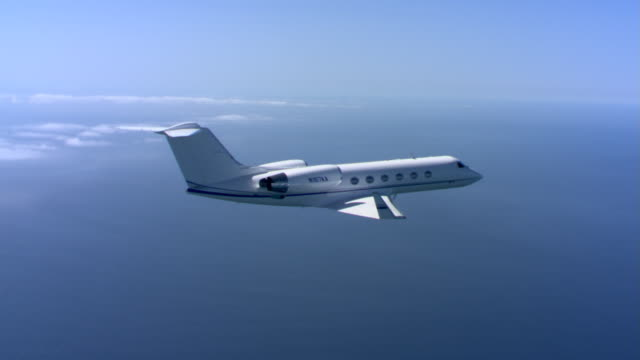 small jet in mid-air - private jet stock videos & royalty-free footage