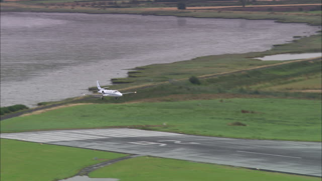 small jet landing at derry airport - derry northern ireland stock videos & royalty-free footage