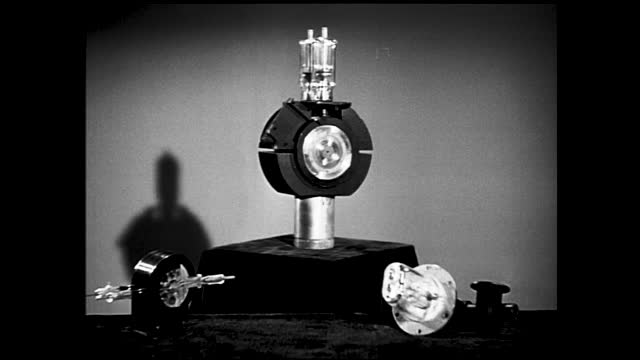 small light up light bulb against the dark background; waves on a spectral analysis monitor; zoom in view of a large bulb mounted on a rotating stand - 1940 1949 stock videos & royalty-free footage