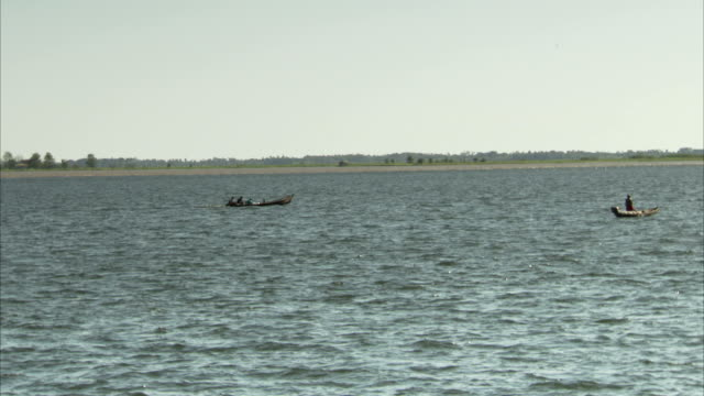 A small motorboat cruises through choppy water near Santarem, Brazil Available in HD.