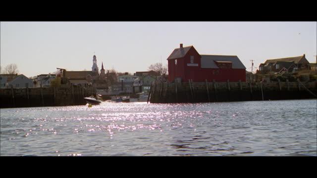 stockvideo's en b-roll-footage met pan small motorboat moving on still water away from rural town / sitka, alaska, united states - alaska verenigde staten