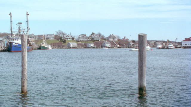 a small motorboat travels in a harbor on martha's vineyard. - 1995 stock videos & royalty-free footage
