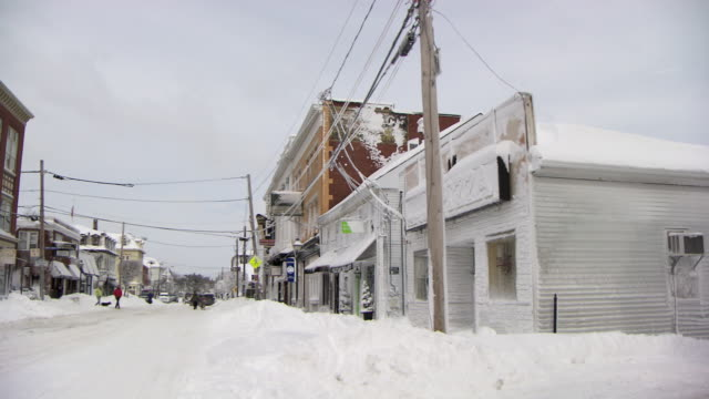 Small New England town after heavy snowstorm - pan