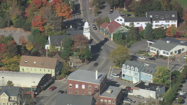 aerial small new england town with white church spire and intense fall foliage / york, maine, united states - maine stock videos & royalty-free footage