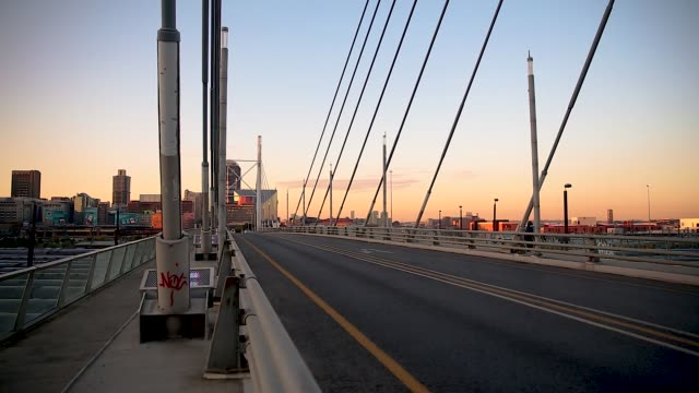 small number of cars crossing over an empty nelson mandela bridge - epidemic stock videos & royalty-free footage