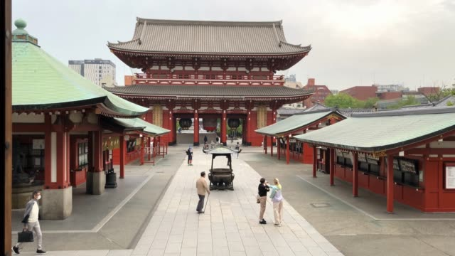 vídeos de stock, filmes e b-roll de small number of people visit sensoji temple, one of tokyos most popular tourist sites, during the coronavirus pandemic on april 21, 2020 in tokyo,... - number 9