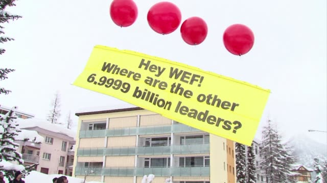 A small number of protesters gathered outside the World Economic Forum meeting in Davos on Wednesday sending a banner into the air with four helium...