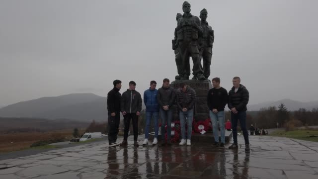 small number of serving and former royal marine commandos gather at commando memorial to commemorate and pay respect to the sacrifice of service men... - remembrance sunday stock videos & royalty-free footage