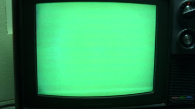 CU Small old style television set with green screen