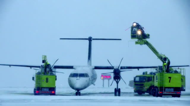 A small plane being de-iced