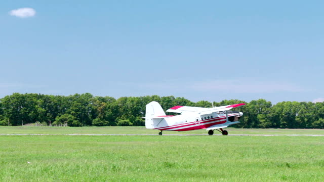a small plane is taxiing on the runway. - tracking shot stock videos & royalty-free footage