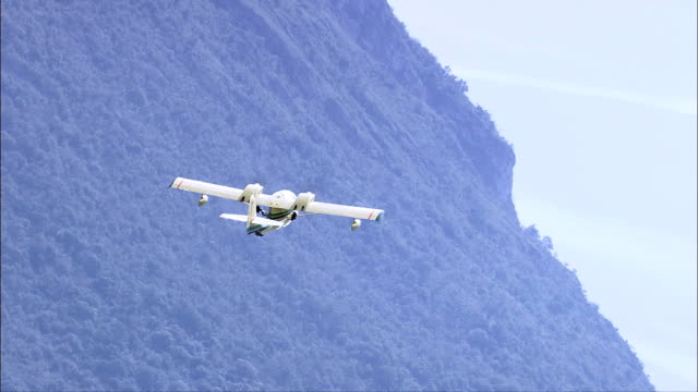 small plane over lake iseo  - aerial view - lombardy, provincia di brescia, pisogne, italy - parade float stock videos and b-roll footage