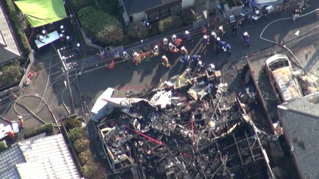small private aircraft crashed into homes in chofu in the suburbs of tokyo on sunday morning, killing three people and injuring four others, police... - 800 meter stock videos & royalty-free footage