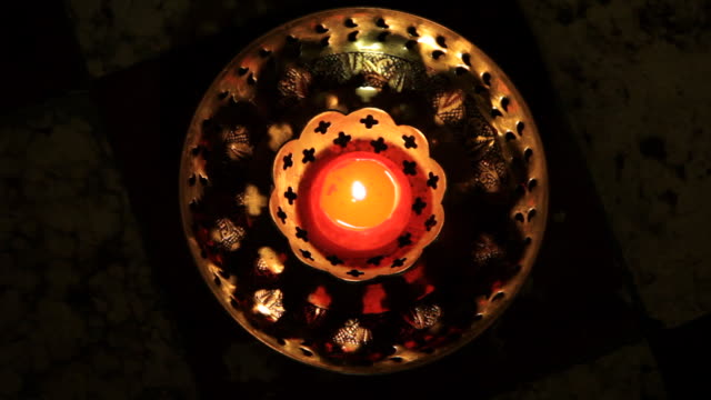 ms  small red candle burning in bronze candle holder / singapore - candle stock videos & royalty-free footage
