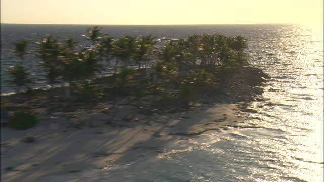 AERIAL Small resort island near Nassau at sunset, Bahamas